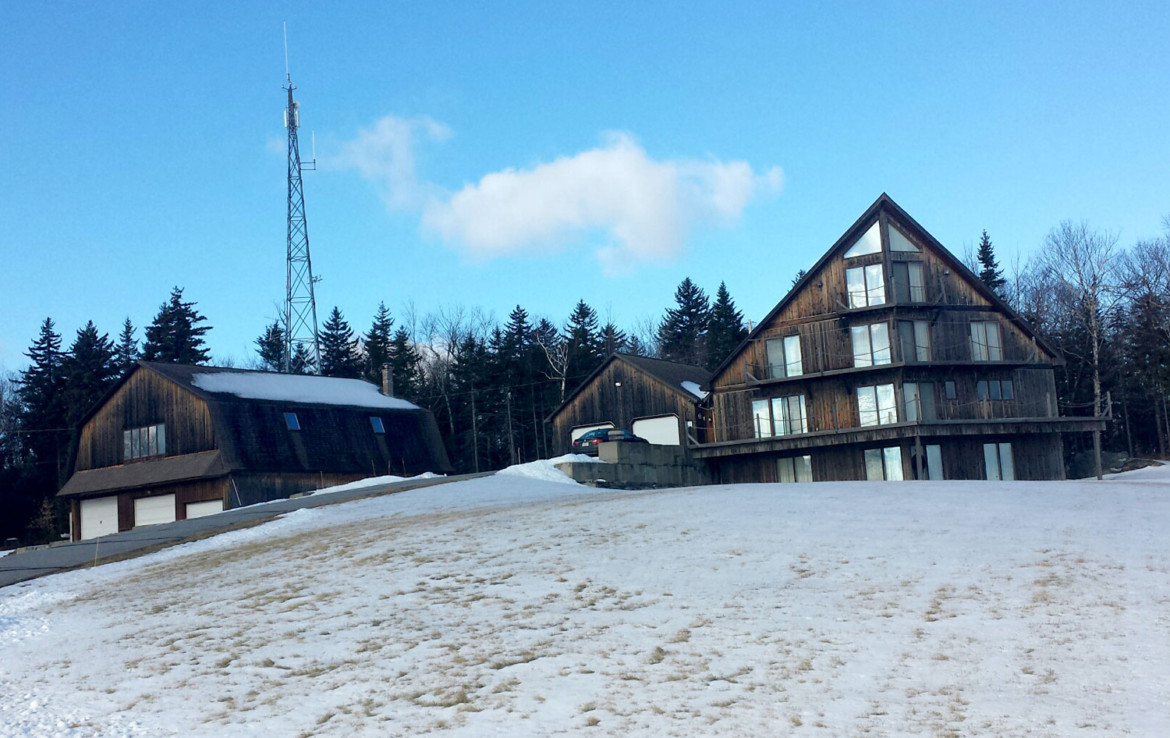 Vermont property in the winter with cell towers